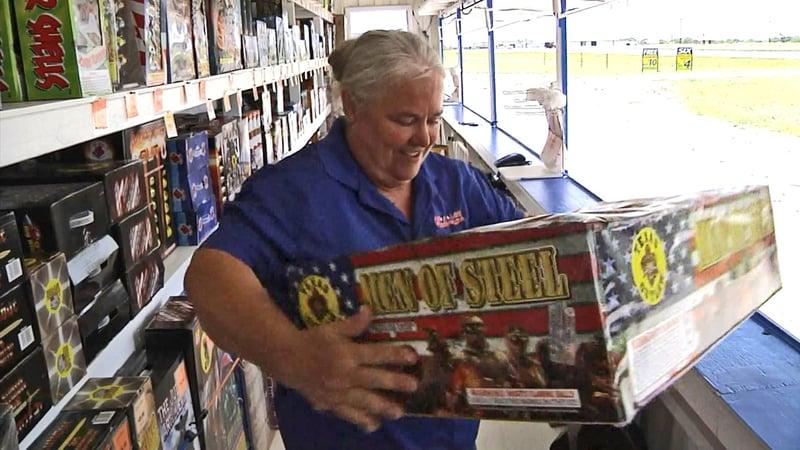 A Grayson County fireworks merchant reviews her inventory. (KTEN)