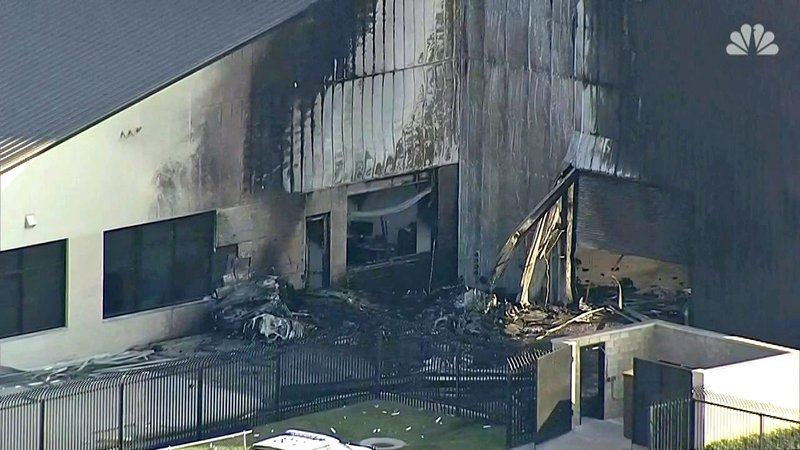 A hangar at Addison Airport was damaged after a plane crashed into it on June 30, 2019, killing all 10 aboard. (NBC News)