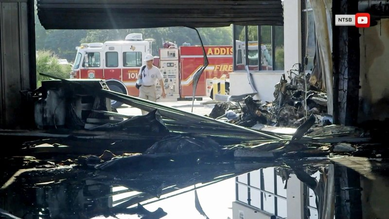 A hangar at Addison Municipal Airport was heavily damaged when a twin-engine plane crashed on June 30, 2019. (NTSB via NBC News)