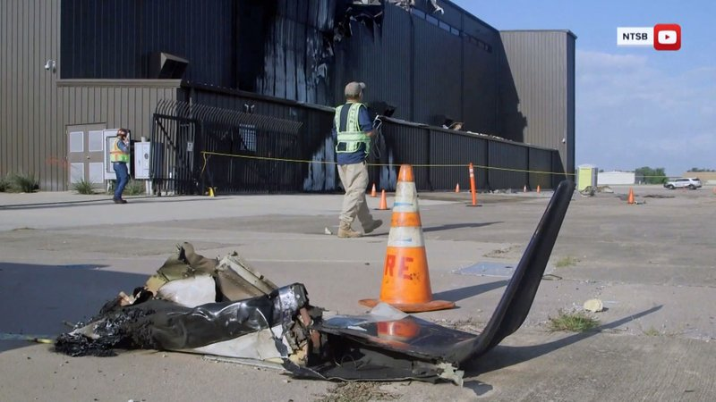Aircraft debris outside a hangar at Addison Municipal Airport where a plane crashed on June 30, 2019. (KTEN)
