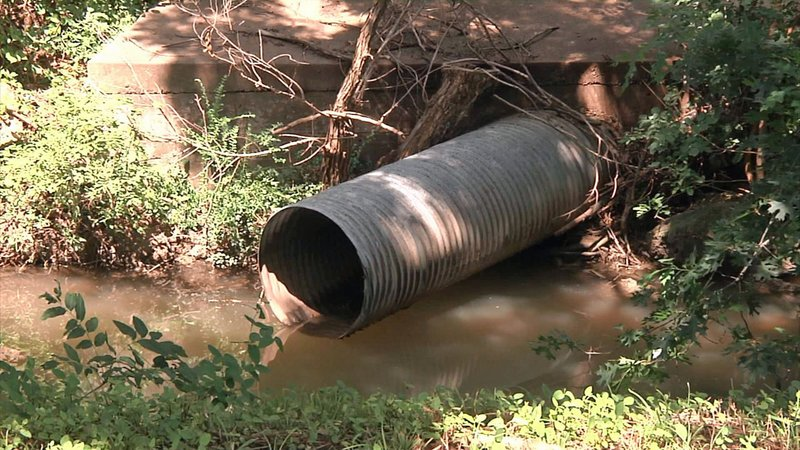 Sherman plans to replace this culvert under Lamberth Road with four higher-capacity pipes. (KTEN)