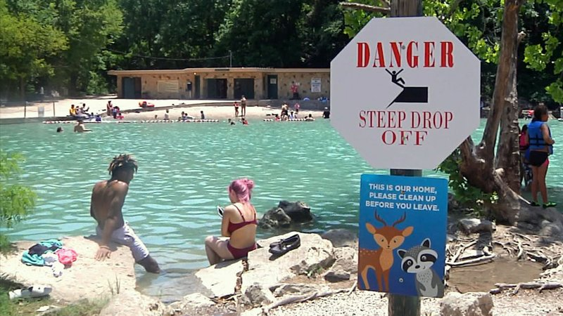 New signs warn of dangers to swimmers at Turner Falls. (KTEN)