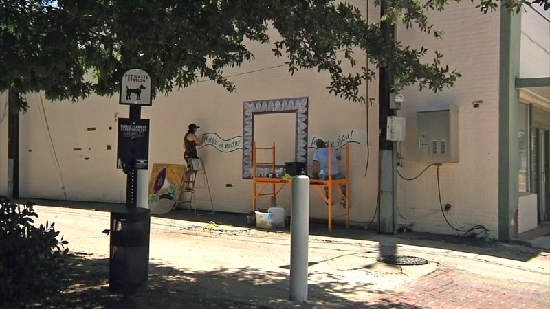 New murals are appearing around downtown Denison. (KTEN)