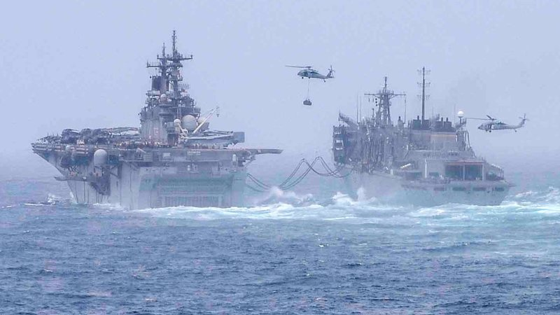 The USS Boxer (left) in the Arabian Sea on July 14, 2019. (U.S. Navy Photo/Spc. 2nd Class Curtis D. Spencer)