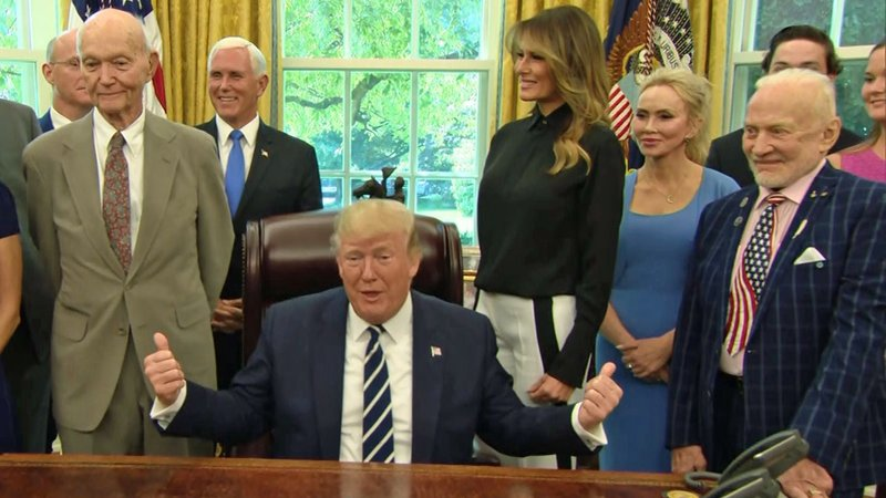President Trump greeted surviving Apollo 11 astronauts Mike Collins, left, and Buzz Aldrin, right, in the Oval Office. (CNN)