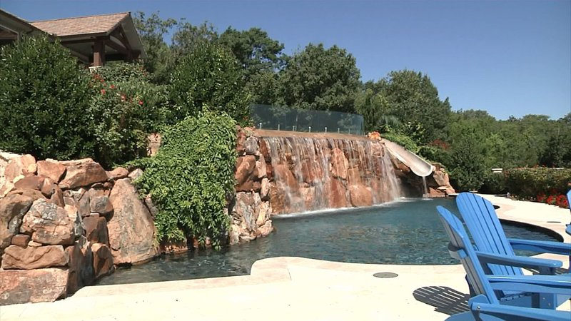A waterfall is part of the landscape of this swimming pool on Lake Texoma. (KTEN)