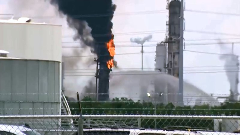 Firefighters work to control a fire at the Exxon Mobil refinery in Baytown, Texas, on July 31, 2019. (KPRC via NBC News)