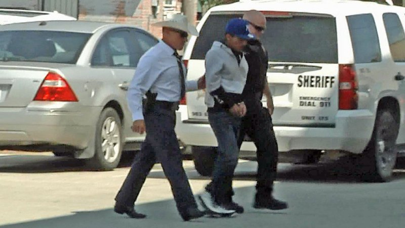 Antonio Prado is escorted to the Grayson County Jail after being extradited from Mexico. (KTEN)