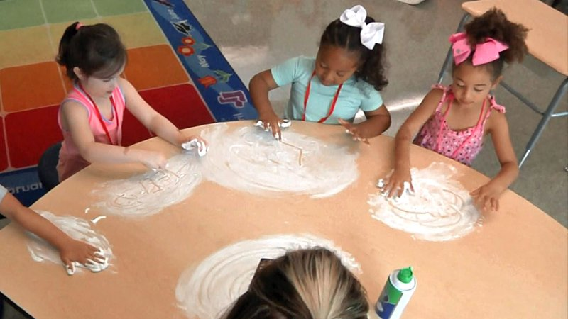 Shaving cream became a canvas for Sherman students attending Kinder Camp. (KTEN)