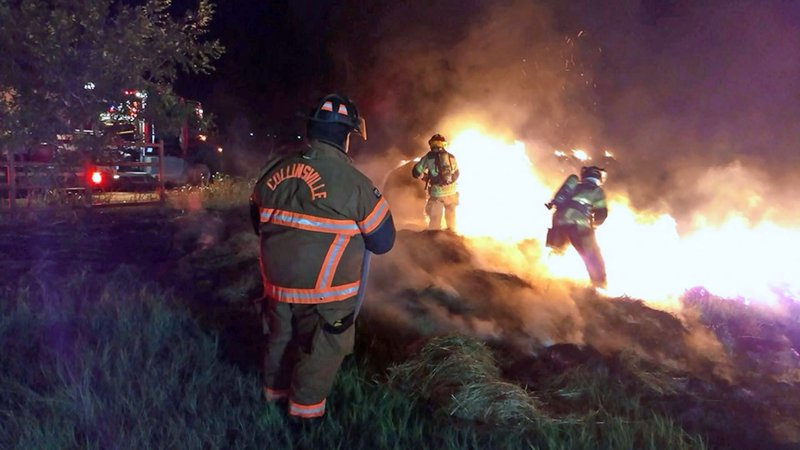 Firefighters work to extinguish a hay bale fire in Whitesboro. (Courtesy Whitesboro FD)