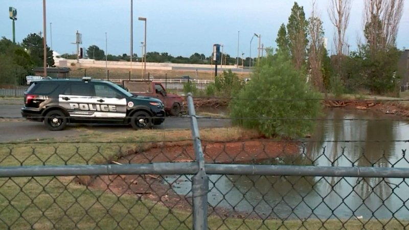 Two men were found dead in a pickup truck that was submerged in a pond in Moore, Oklahoma. (KFOR via NBC News)