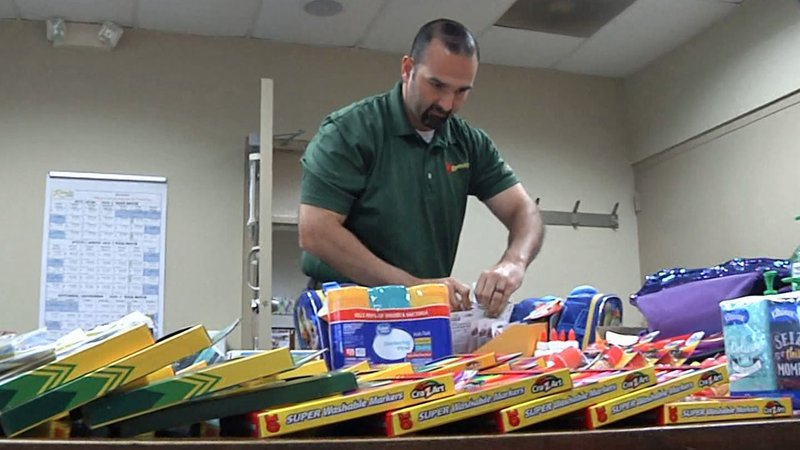 School supplies donated by Ruiz Foods employees are prepared for distribution to foster kids. (KTEN)