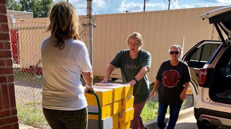 Love PV volunteers deliver school supplies. (Courtesy)