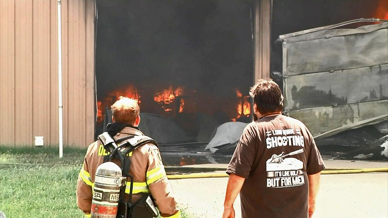 Flames engulf the house and shop on FM 84 in Denison. (KTEN)