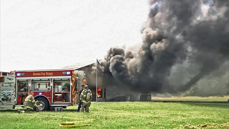 Denison firefighters battle the flames at a residence on FM 84. (KTEN)