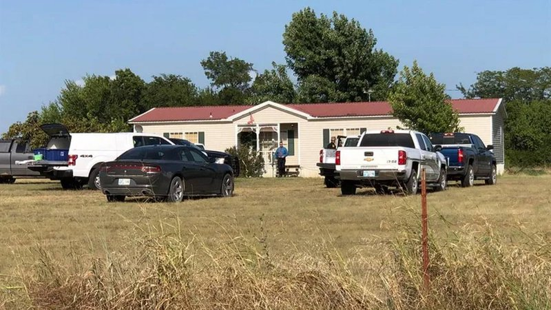 A woman and two children were found dead in this mobile home near Powell, Oklahoma, on August 22, 2019. (KTEN)