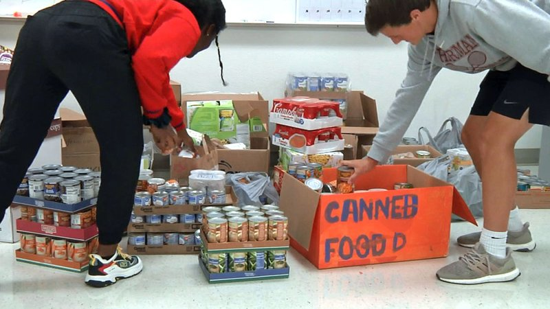A canned food drive competition is part of the Battle of the Ax activities. (KTEN)