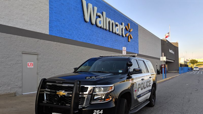 A Sherman police car parked in front of Walmart on August 6, 2019, three days after a mass shooting at an El Paso Walmart. (KTEN)