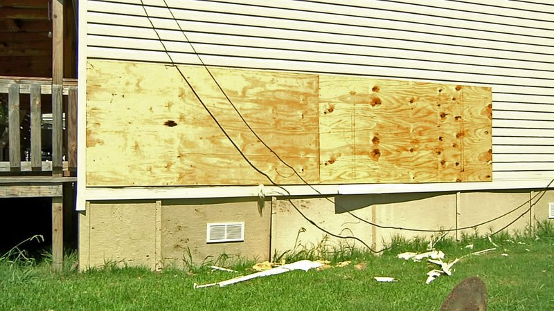 A home on Carter Street in Ardmore is boarded up where an SUV drove into it early Saturday morning. (KTEN)
