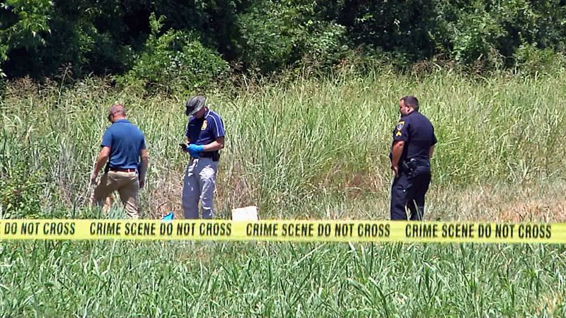Ardmore police examine the location where a man's body was found on July 25, 2019. (KTEN)
