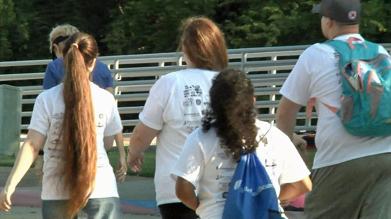 Participants in the Texoma Caregiver Celebration Walk at Grayson College. (KTEN)