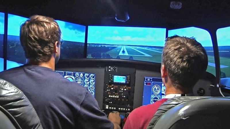 Students use a flight trainer at SOSU. (KTEN)