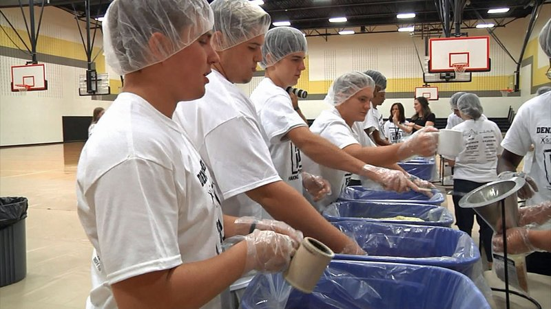 Denison High School students work on their Feed the Need project. (KTEN)