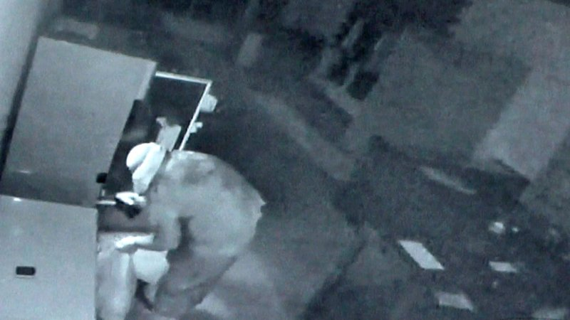 A man wearing a plastic bag on his head burglarized a Pauls Valley marijuana dispensary on September 15, 2019. (Surveillance photo)