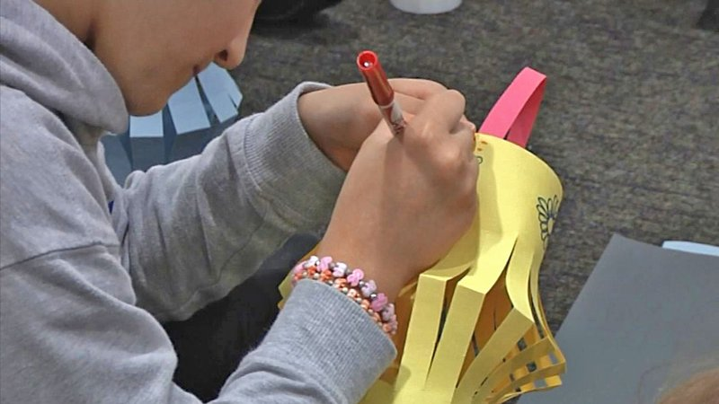 A grade school student decorates a paper lantern at a 'Roo Bound event at Austin College on September 21, 2019. (KTEN)