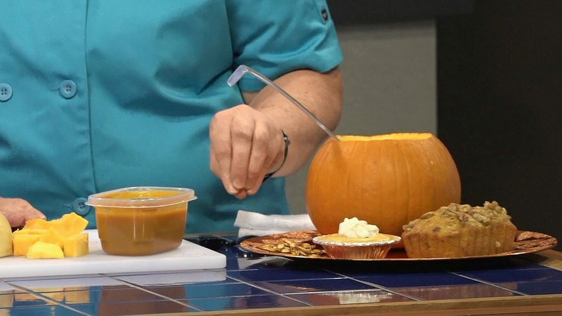 Prop-Strike Cafe executive chef Diana Larkins shows off some of her favorite gourd-related menu items. (KTEN)