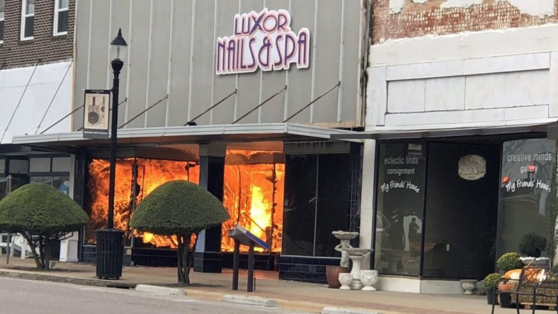 Flames engulfed the Luxor Nails & Spa in downtown Denison on October 9, 2019. (KTEN)