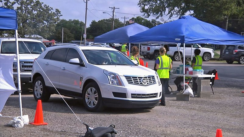 Residents of Madill lined up Thursday for a flu shot drive-thru clinic. (KTEN)