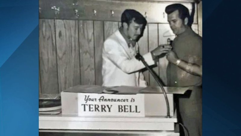 Terry Bell saved this photograph of him interviewing Conway Twitty at a live remote in Ada. (Courtesy)
