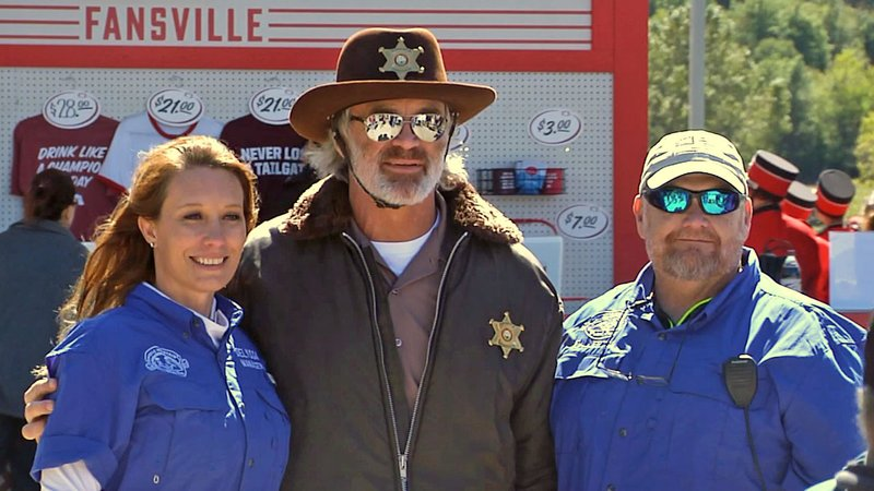 Brian Bosworth poses for photos with fans in Davis. (KTEN)
