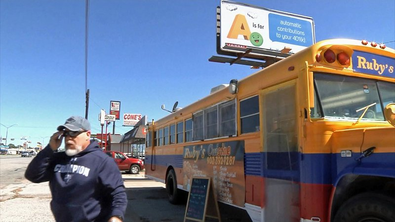 Ruby's Cuisine serves up Colombian specialties from this school bus in Sherman. (KTEN)