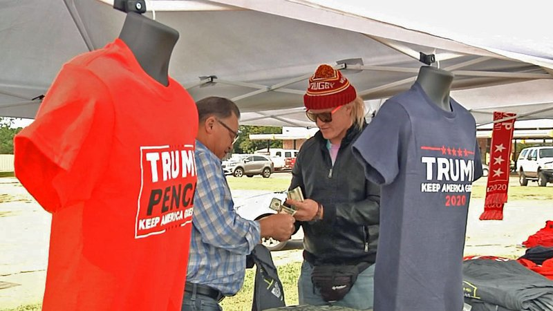 A traveling Trump merchandise shop popped up in Whitesboro ahead of the president's rally in Dallas. (KTEN)