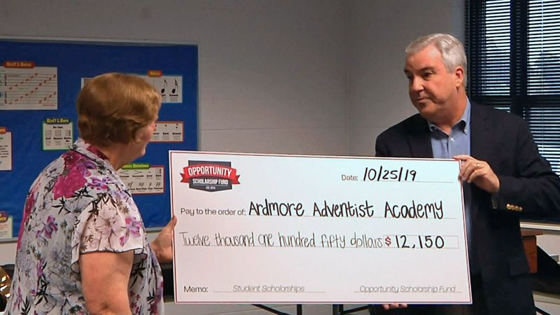A scholarship check is presented to Ardmore Adventist Academy on October 25, 2019. (KTEN)