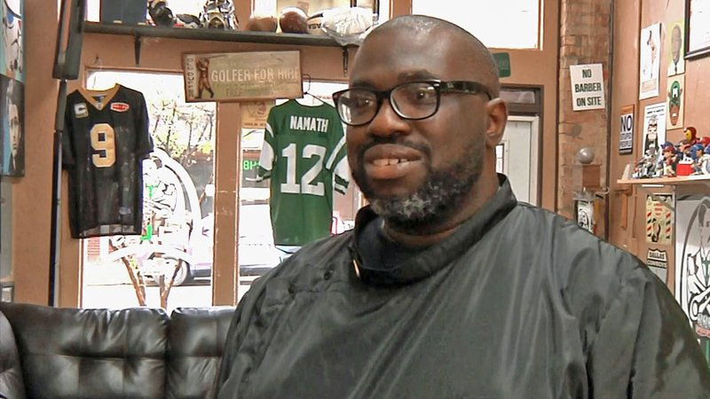 Hal Hinton is asking the City of Sherman to approve his plan for a cigar lounge behind his barbershop. (KTEN)