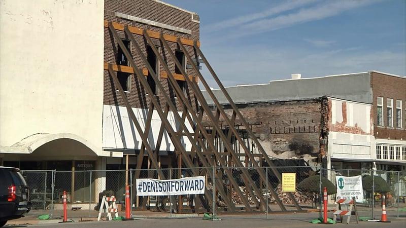 The facade of a Denison Main Street building damaged in the October 9, 2019 fire has been reinforced. (KTEN)