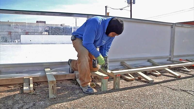 A worker prepares the Denison on Ice rink. (KTEN)