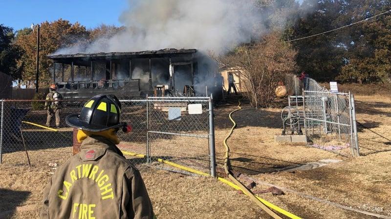 Firefighters attack a house fie in Cartwright on November 15, 2019. (KTEN)