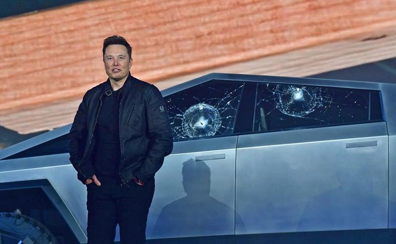 Tesla CEO Elon Musk stands in front of shattered windows during the Cybertruck demonstration on November 21, 2019. (Tesla)