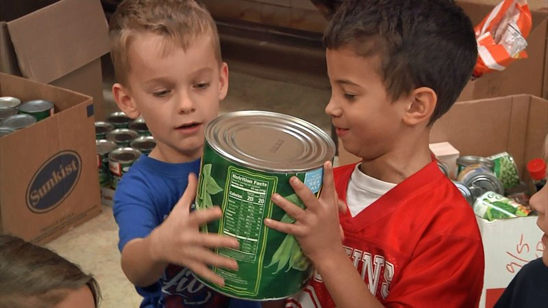 Durant students help pack items for the Bryan County food drive. (KTEN)