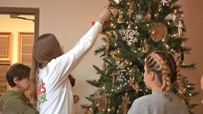 Waples Memorial Church youth help decorate for the Christmas season. (KTEN)