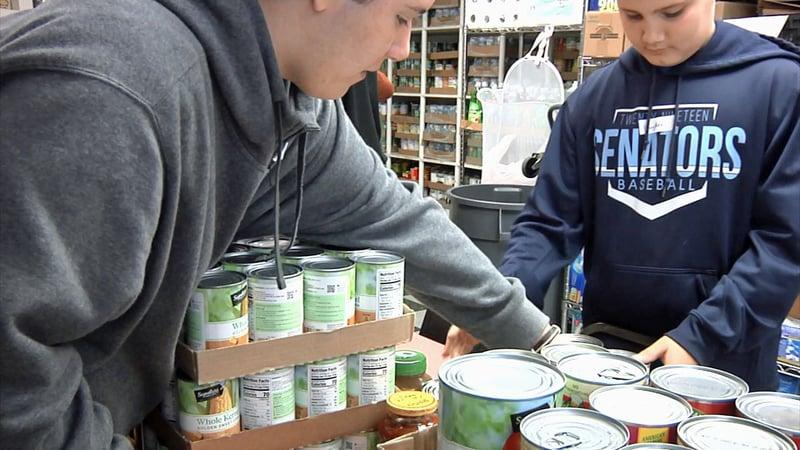 Waples Church lend a hand at the Helping Hands Food Pantry. (KTEN)