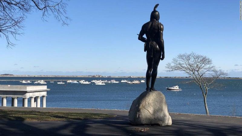 A statue of Massasoit Ousamequin overlooks the sea at Cole's Hill. (Pamela Kirkland/CNN)
