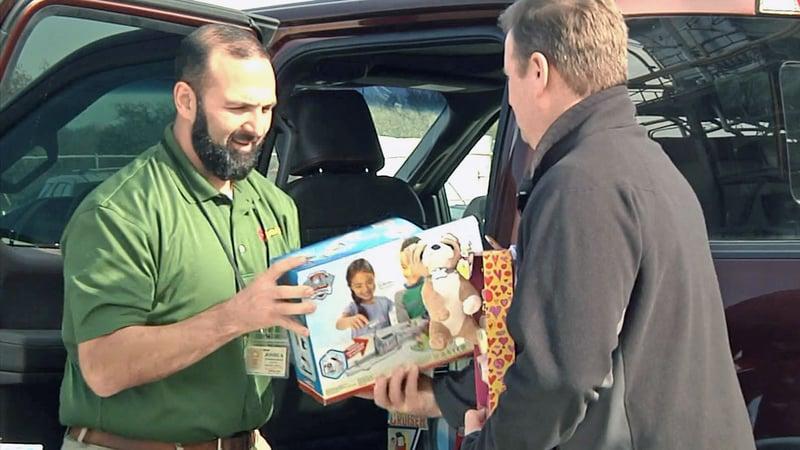 Ruiz Foods employees load toys bound for foster kids in Grayson County. (KTEN)