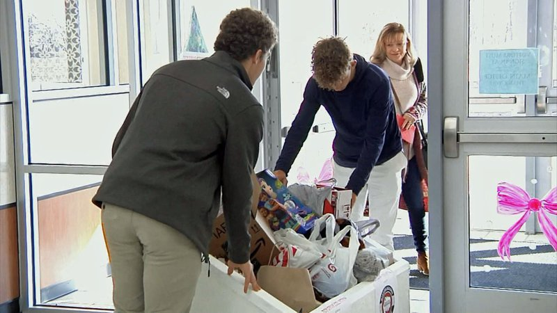 Van Alstyne High students load toys collected for victims of child abuse. (KTEN)