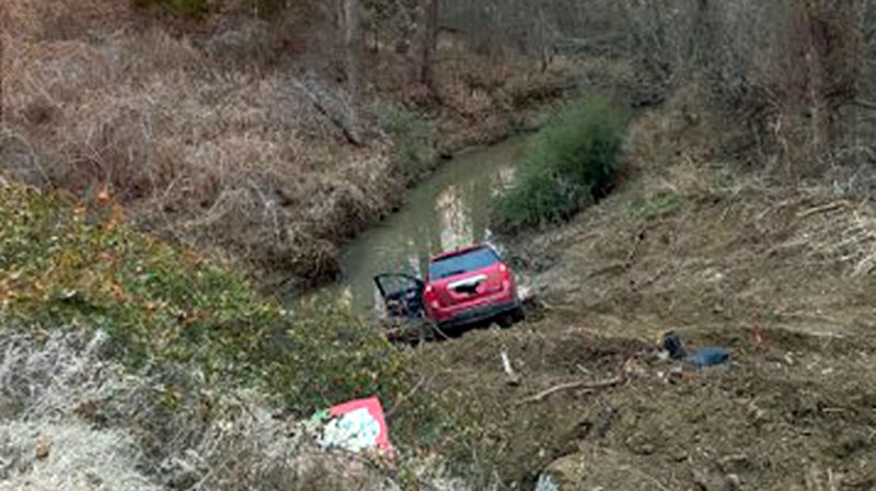 A stolen red SUV ended up in a Calera creek. (Courtesy)