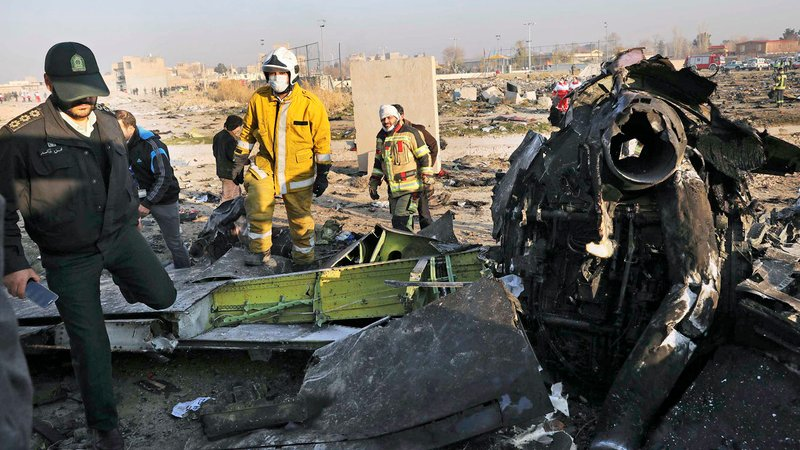Eighty-two Iranians, 63 Canadians, and 11 Ukrainians died in the crash of a Ukrainian International Airlines jet near Tehran. (Ebrahim Noroozi/AP)